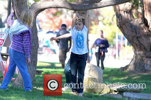 Kingston Rossdale hanging from a tree at a...