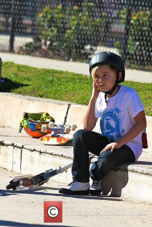 Kingston Rossdale takes a rest from riding his...