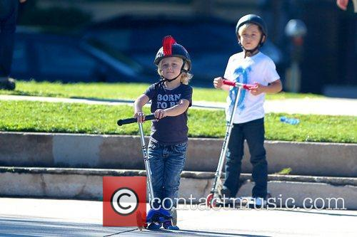 Zuma Rossdale and Kingston Rossdale riding their scooters...