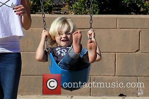 Zuma Rossdale on a swing at a park...