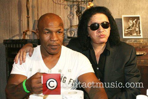 Mike Tyson and Gene Simmons attend an event...