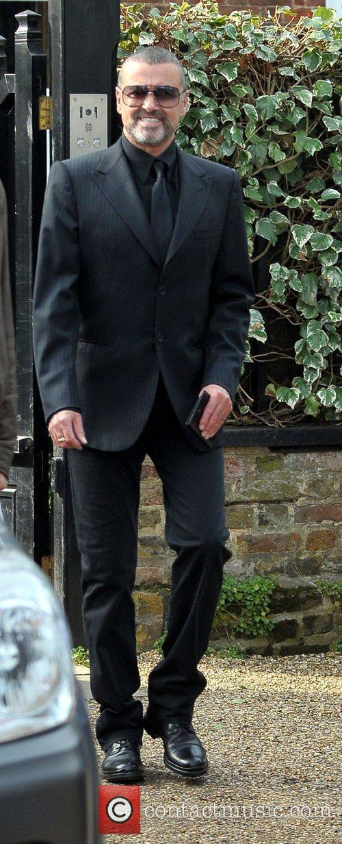 Leaving his house. George asked waiting photographers if...