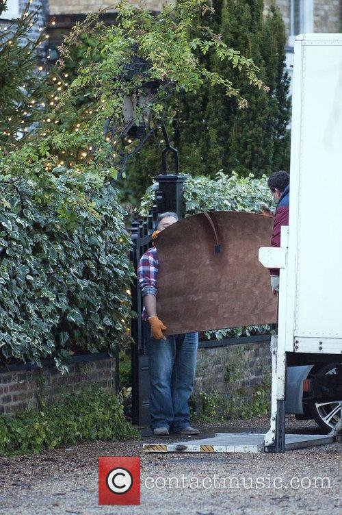 a bed being delivered to george michaels 3663361