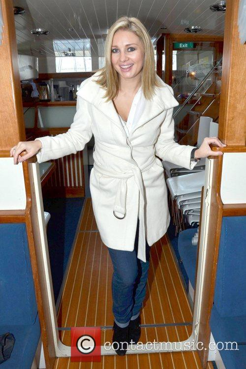 Anne Daly conducts an interview on board a...