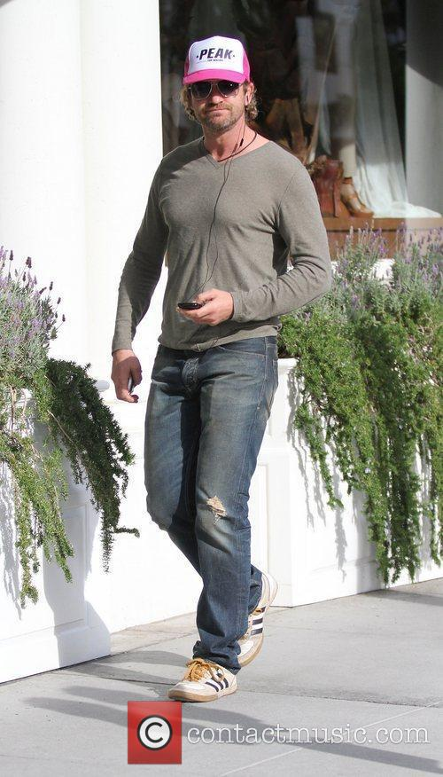 Gerard Butler goes shopping on Rodeo Drive in...