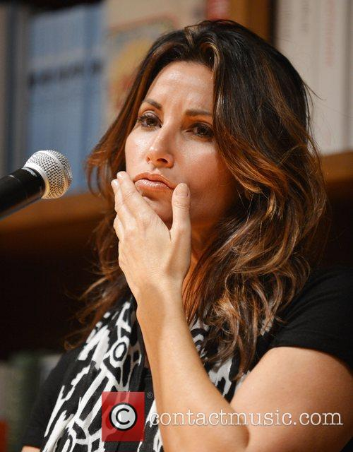 Gina Gershon greets fans and signs copies of...