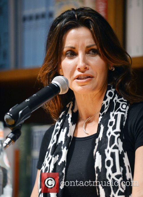 Gina Gershon Gina Gershon greets fans and signs...