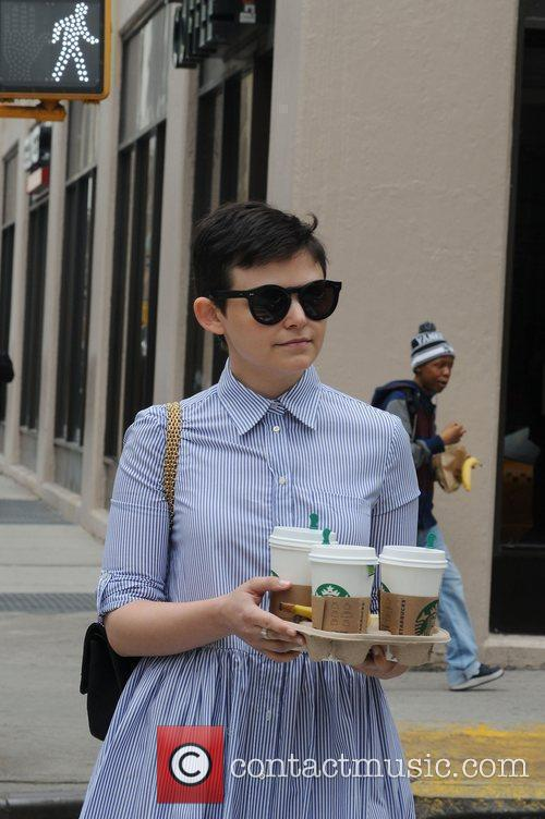 Picks up some coffee from Starbucks in Manhattan