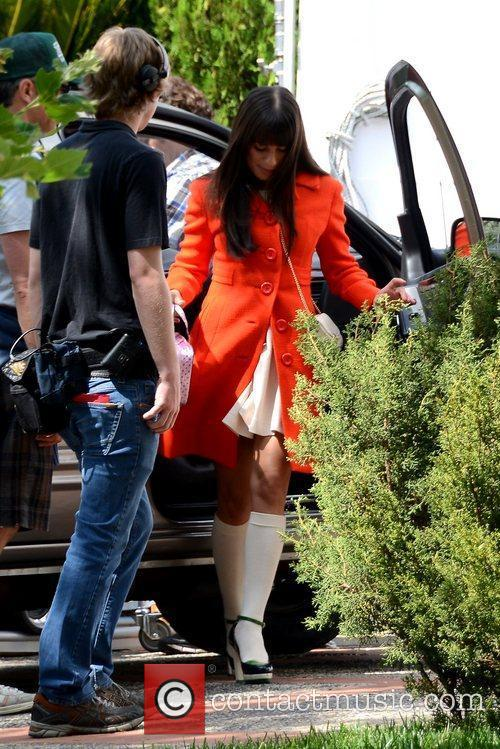 Wearing an orange coat during filming of 'Glee'...