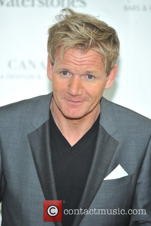 Signs his book 'Gordon Ramsay's Ultimate Cookery Course'...
