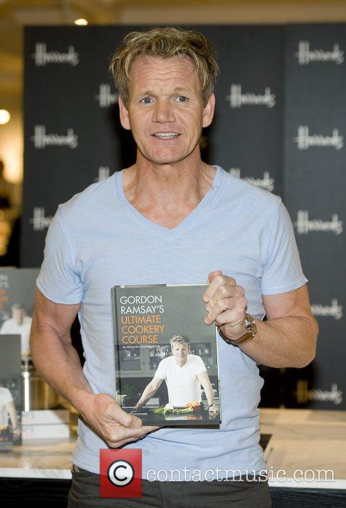 Signs copies of his latest book 'Gordon Ramsay's...