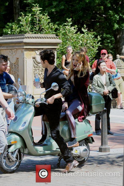 Blake Lively and Penn Badgley  ride a...