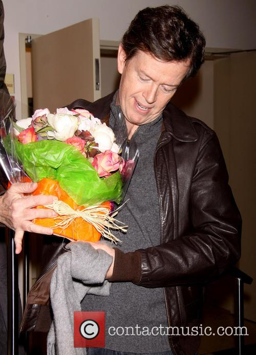 Dylan Baker (bringing flowers to his wife Becky...