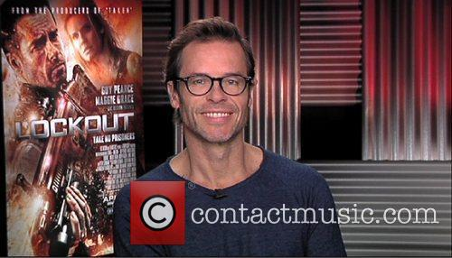 Promotes his new movie 'Lockout' during an interview