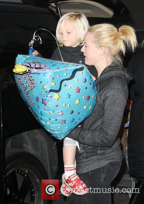 Zuma Rossdale is carried by the family child...