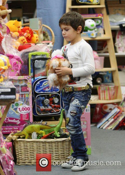 Kingston Rossdale checks out the children's toys while...