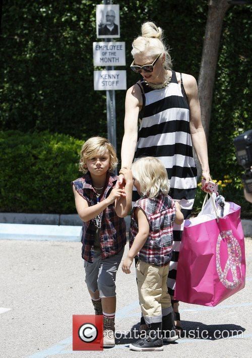 Gwen Stefani arrives at a kids party with...