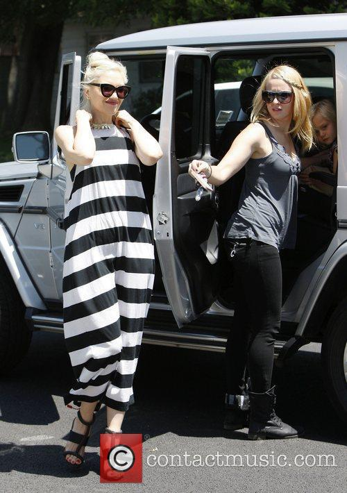 Gwen Stefani arrives at a kids party wearing...