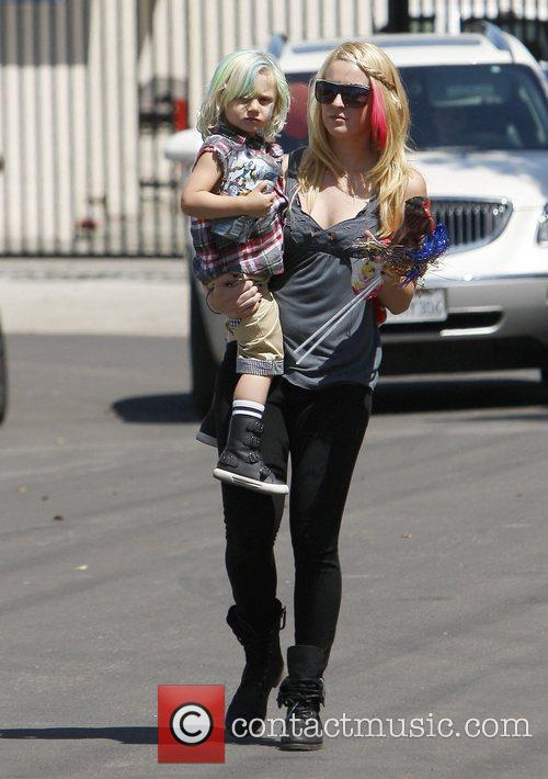 Zumaa Rossdale is carried by his child minder...