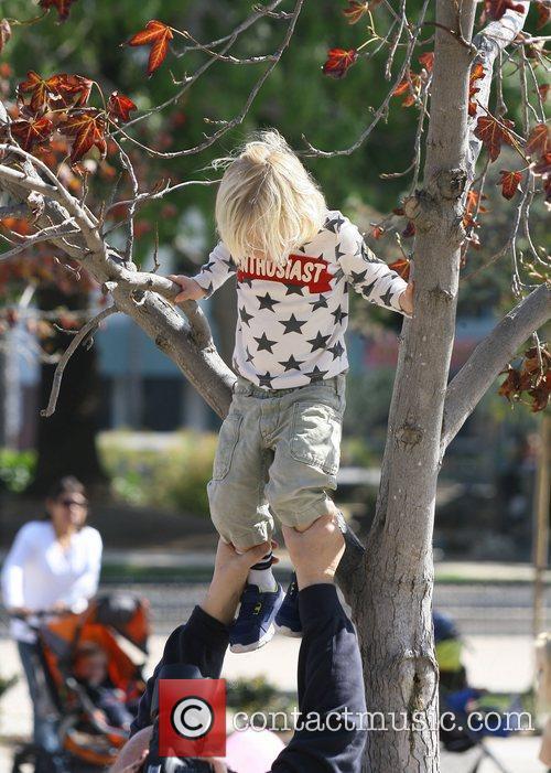 Zuma Rossdale climbs a tree as he attends...