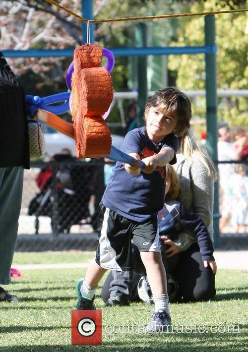 Kingston Rossdale hitting a pinata while spending the...
