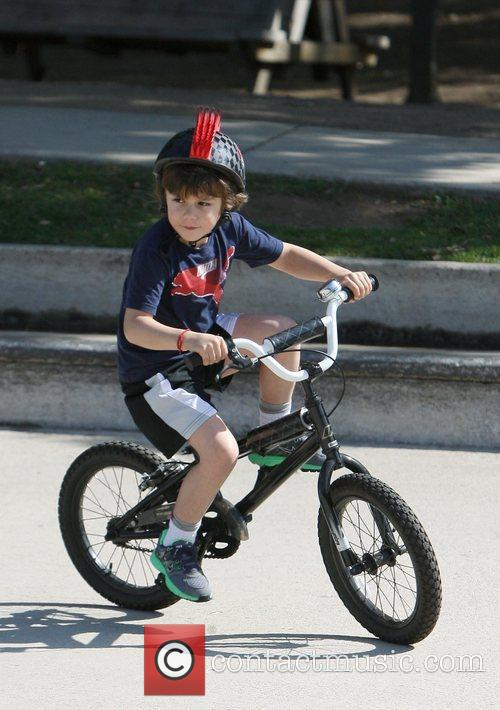 Kingston Rossdale on his bike while spending the...