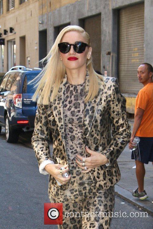 Gwen Stefani dressed in a leopard print suit...