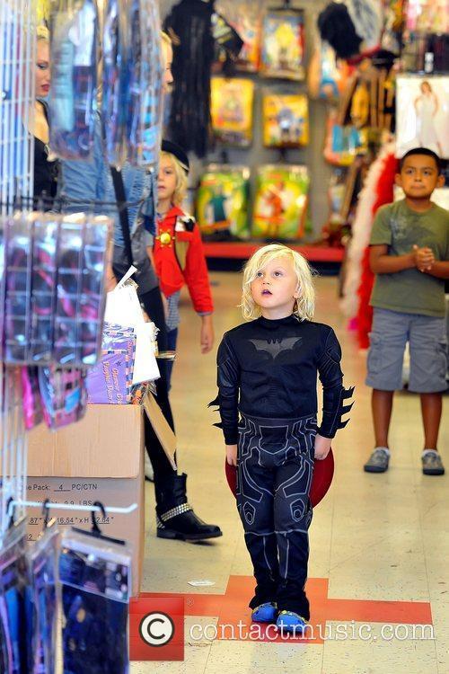 Zuma Rossdale shopping at a costume store with...