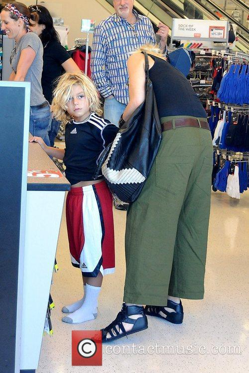 Gwen Stefani shopping at Sports Authority with her...