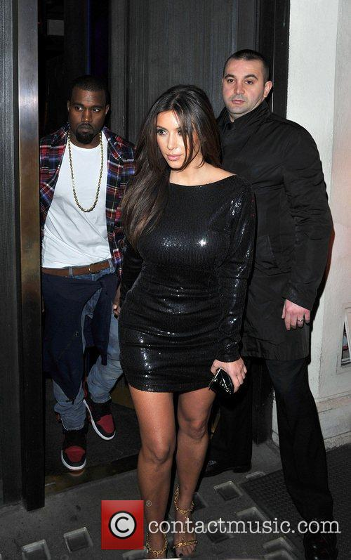 Kanye West and Kim Kardashian leaving Hakkasan restaurant