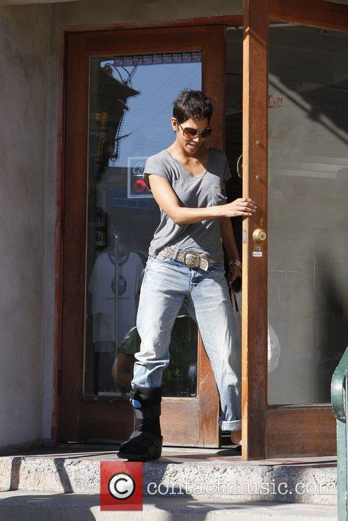 Halle Berry wears a foot brace while shopping...