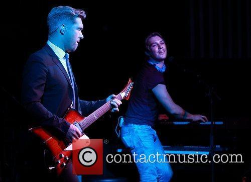 Isaac and Taylor Hanson Hanson perform live at...
