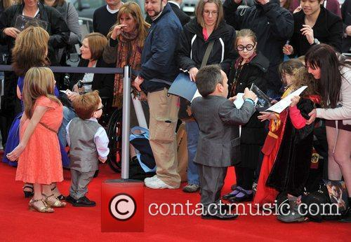Warwick Davis and family The worldwide Grand Opening...