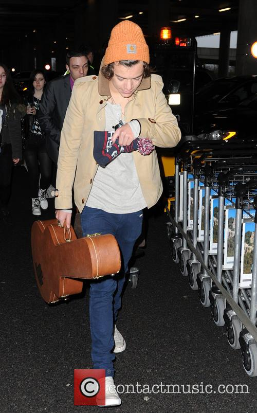 Harry Styles arrives at Heathrow Airport after flying...
