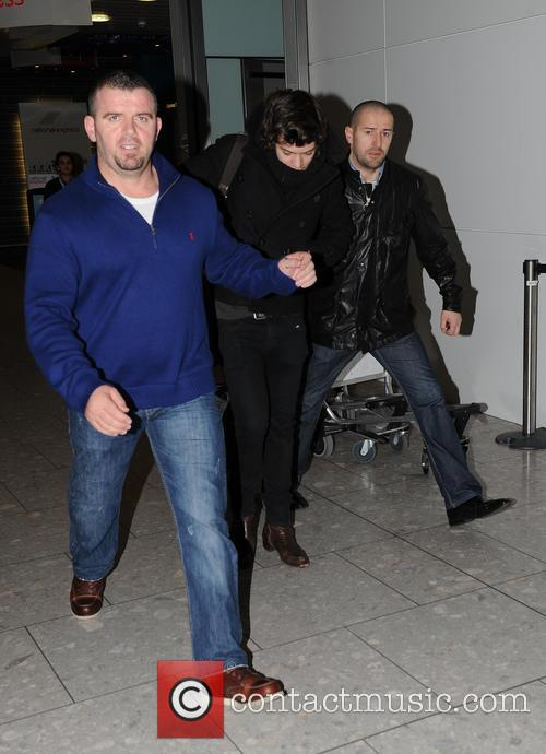 Harry Styles Harry Styles arriving at Heathrow Airport....