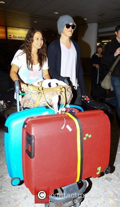 Arriving at Heathrow airport with his fiancee Giovanna...