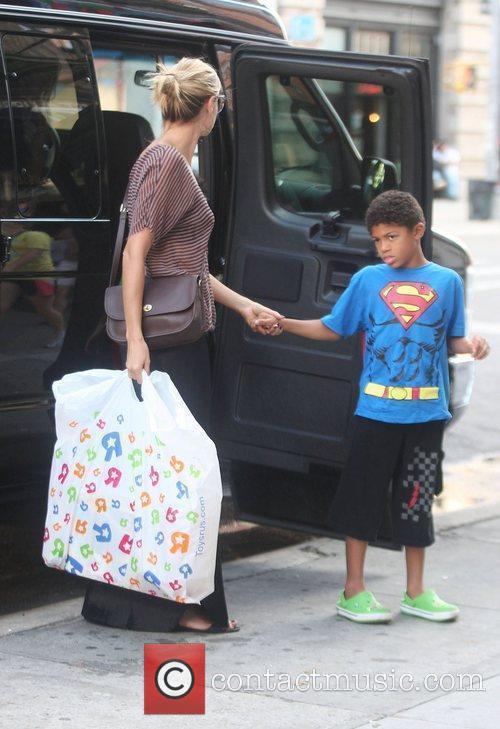 Heidi Klum and the children return home after...