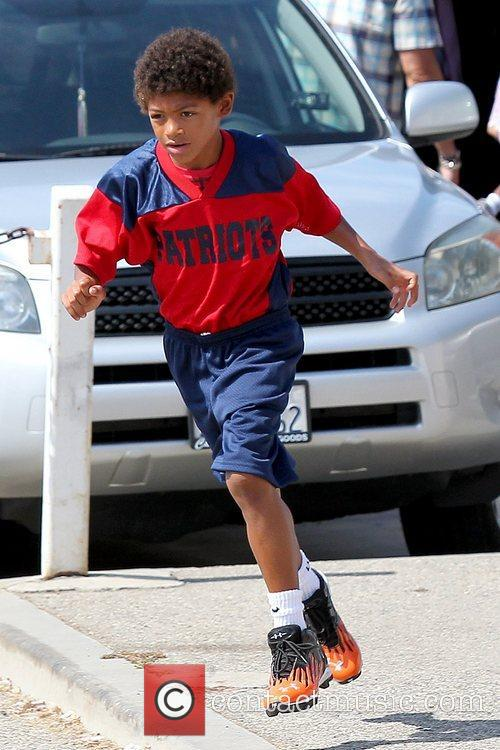 Henry Samuel arriving at his soccer game in...