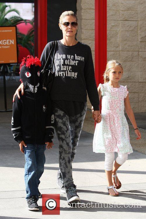 Heidi Klum takes two of her children to...