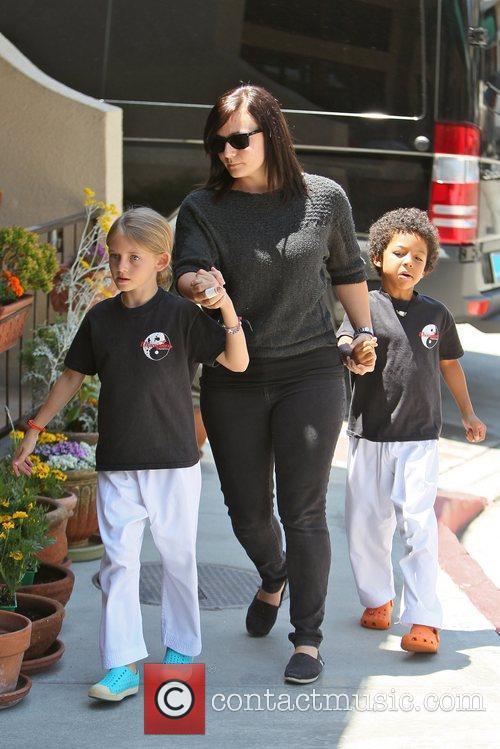 Heidi Klum's children depart a karate class to...