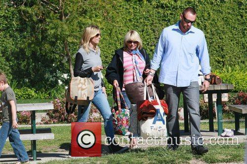 Heidi Klum carrying a Fleurville Diaper Bag on...