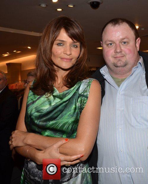Helena Christensen poses with fan  Helena Christensen...