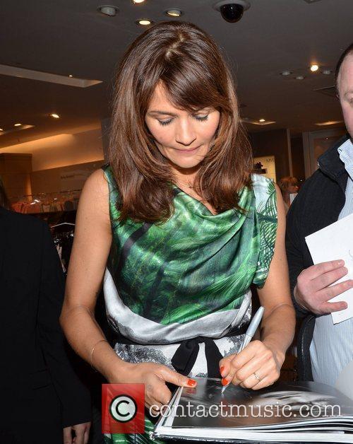 Helena Christensen signs Barry McCall Book Helena Christensen...