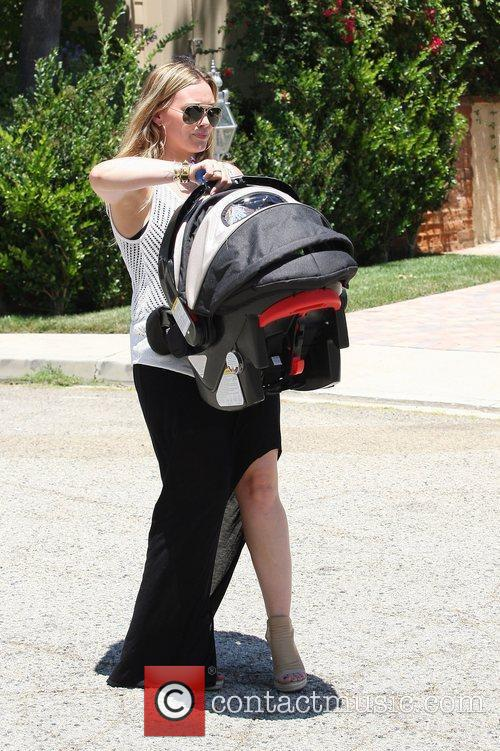 Hilary Duff carries her son Luca Cruz Comrie...