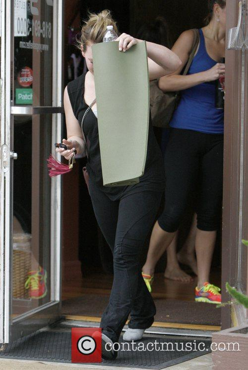 Leaves a Yoga class in Hollywood carrying a...