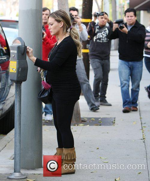 An expectant Hilary Duff is seen in good...