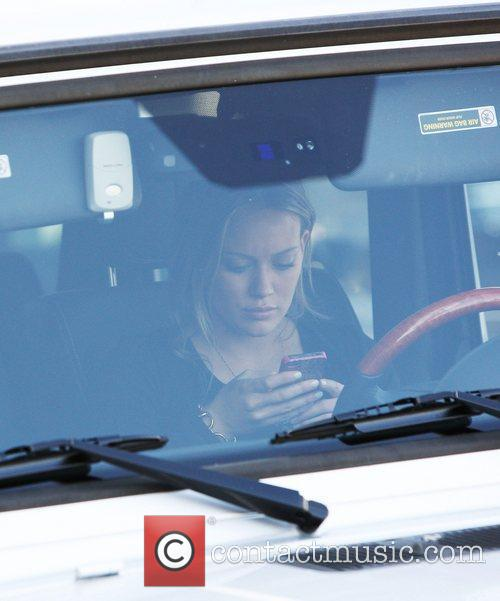 An expectant Hilary Duff makes a call on...