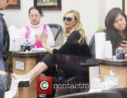 Kimberly Conrad visits a beauty salon in Beverly...