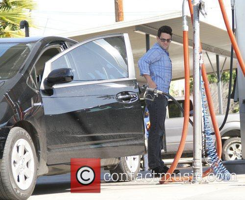 Justin Bartha fills up his car at the...