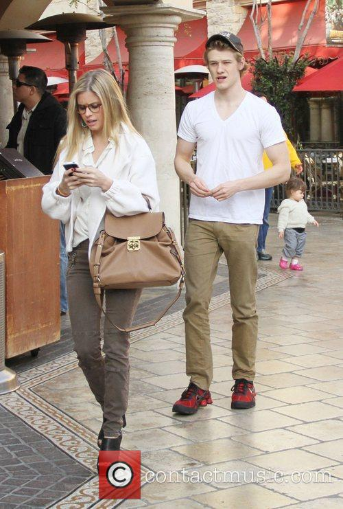 Lucas Till and his girlfriend walk through The...